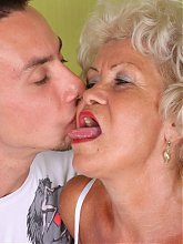 Gray haired vixen with big knockers Francesca is down on her knees to lip service a dick