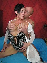 Mature couple rumbling kinky on their bed
