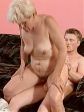 Slutty mature blondie gets her breast licked and after deepthroating a young cock live