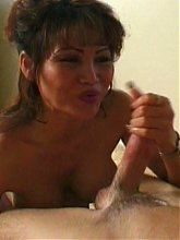 Sexy Grandma Penny gets down and dirty as she gives a monster schlong a mouthfuck live