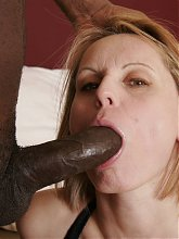 Mature brunette Magda joins a black guy in bed and takes a cock inside her bushy cunt