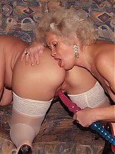 Francesca and Erlene are horny grannies putting up a show and sharing a dildo during a cam show